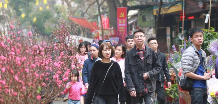 Young people go to the flower market to admire