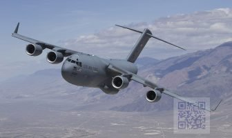 A U.S. Air Force C-17 Globemaster III T-1 flies over Owens Valley, California, for a test sortie