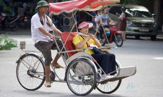 Taking a cyclo in Hanoi, Vietnam