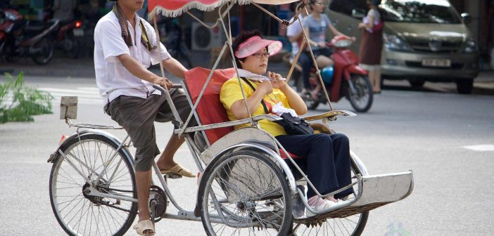 Taking a cyclo in Hanoi, Vietnam