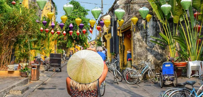 Tourist Wearing Canon Hat In Hoi An